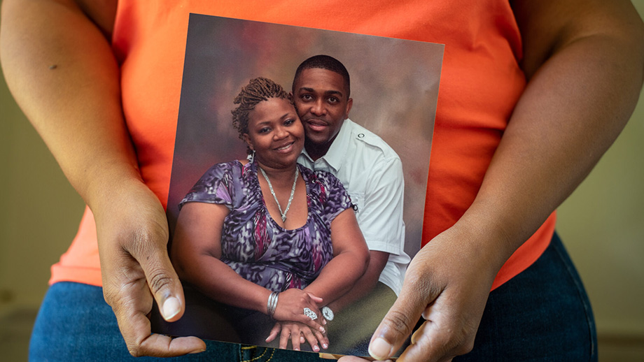 From Stat News: Egerson-Carter holds a picture of her and her late husband who died of colorectal cancer. By Timothy Ivy