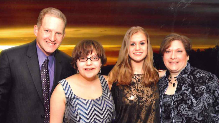 Tammie Feldman at far right, with her husband and daughters.