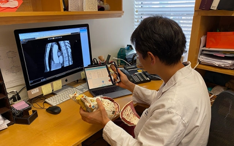 "Cardiac surgeon Dr. Takayama prepares for a video visit with a patient. ""Many of my patients loved them, especially when they didn't have to come into the city. It's very useful."""