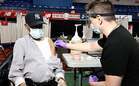 93-year-old Bronx resident, Persio Perez, was among the first to receive the vaccine at the Armory. Photo courtesy of New York-Presbyterian Hospital.